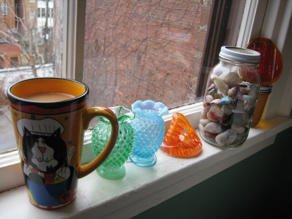 Kitchen window, cup of tea and colored glass