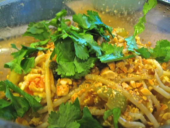 Shrimp pad thai, with crushed peanuts and cilantro leaf.