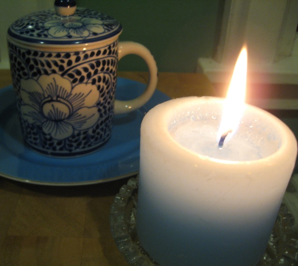 Candle and tea, for the shadowed afternoon.