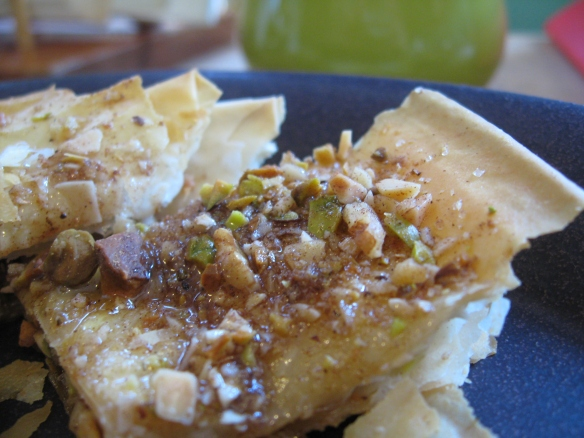 Plated baklava, glistening with honey and crystals of sugar