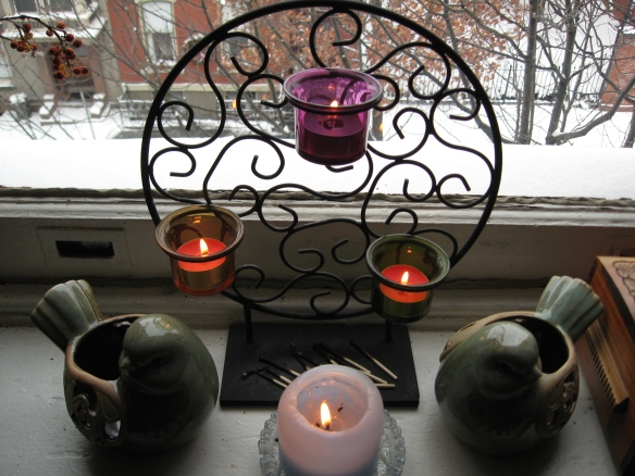 Candles in the yoga room; snowy street outside.