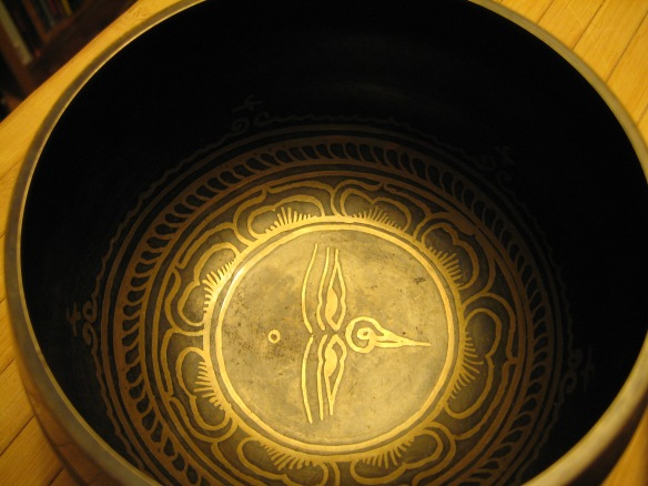 Tibetan singing bowl with symbol of wisdom eyes.